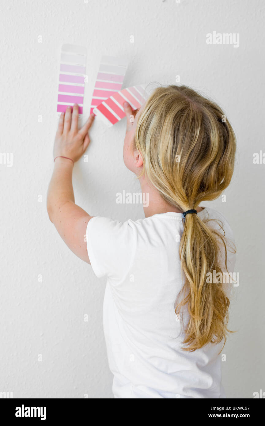 Woman comparing colour scheme - Stock Image