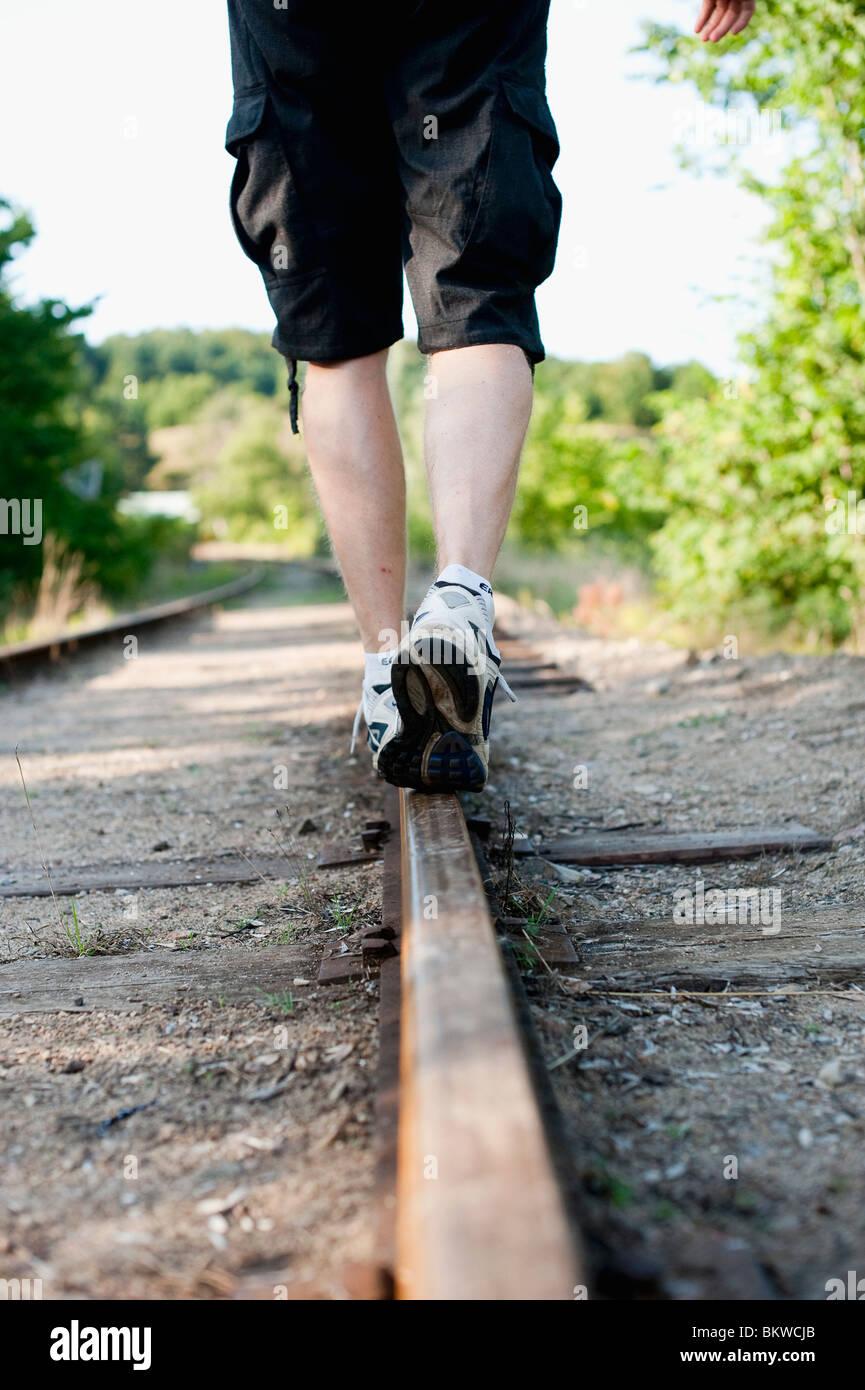 Walk on rail - Stock Image
