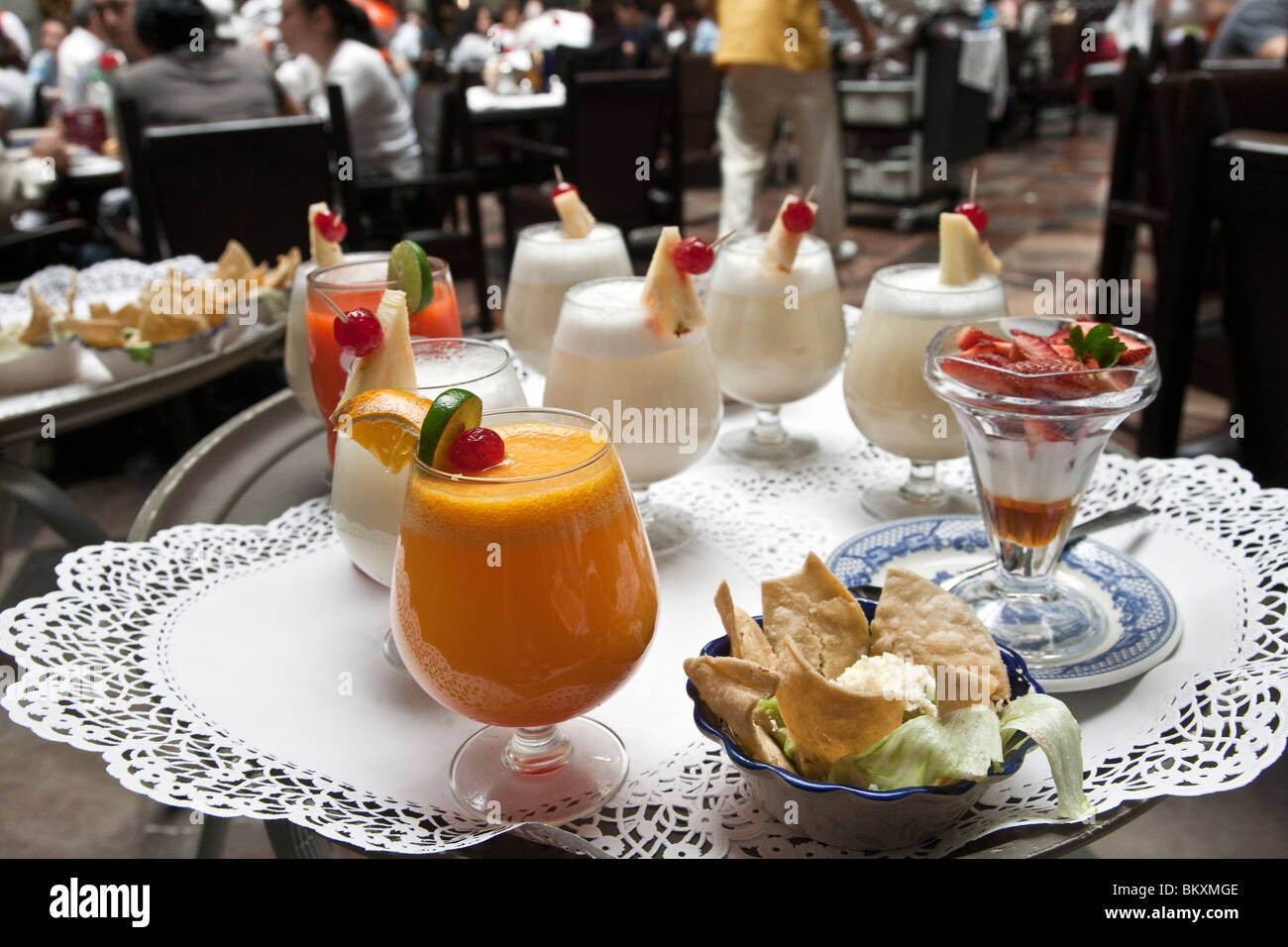 tray of delicious starter non alcoholic beverages and guacamole appetizer waiting for diners at Sanborns House of - Stock Image