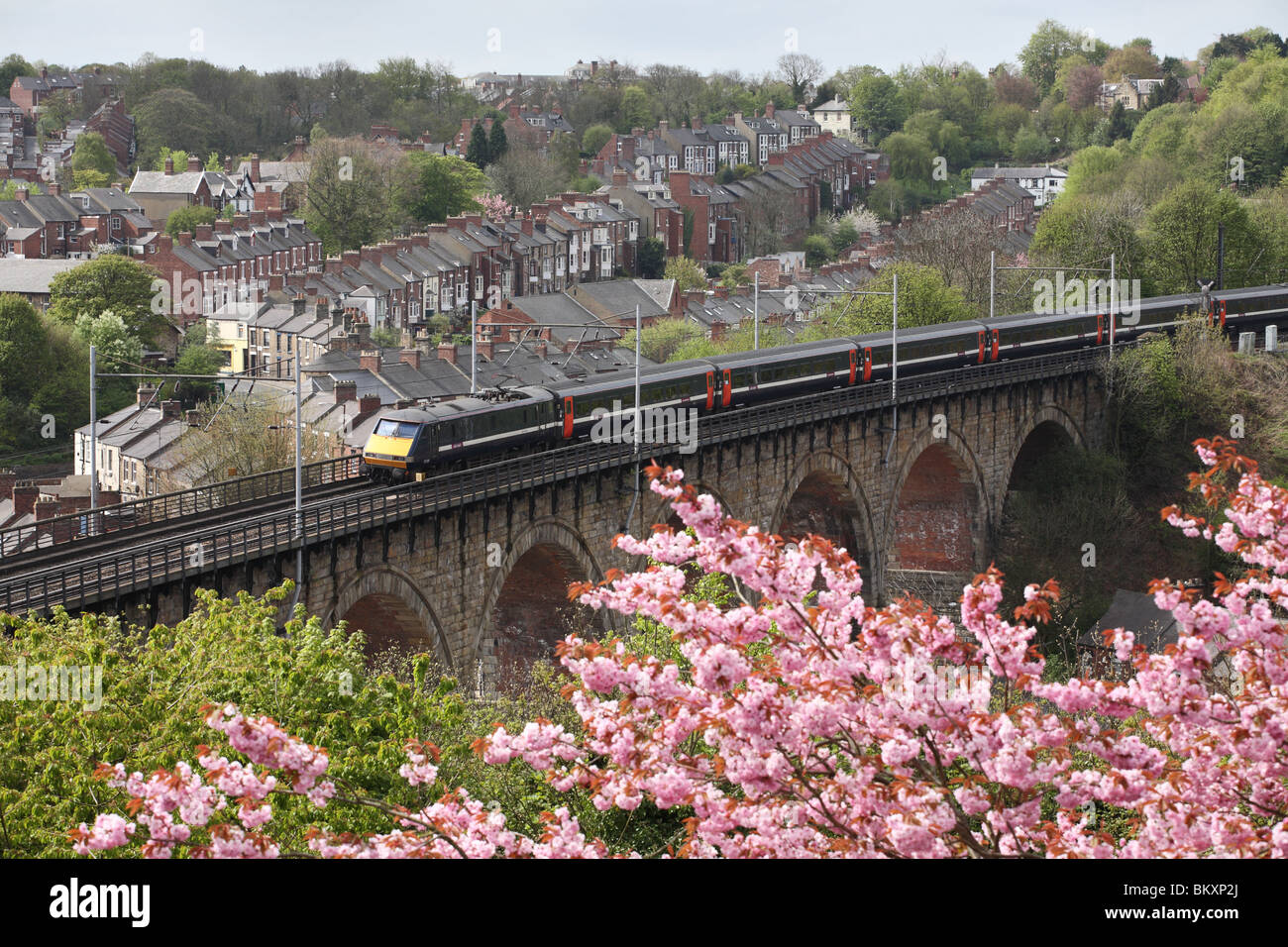 East Coast express passenger electric train crossing the railway viaduct at Durham, England, UK Stock Photo