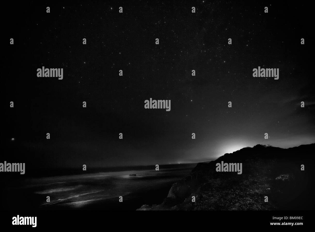 Ocean at night in Cambria, CA. - Stock Image