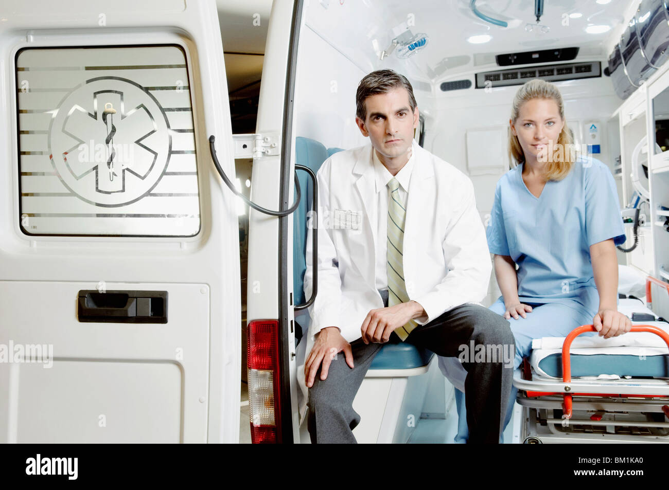 Doctor sitting with a female nurse in an ambulance - Stock Image