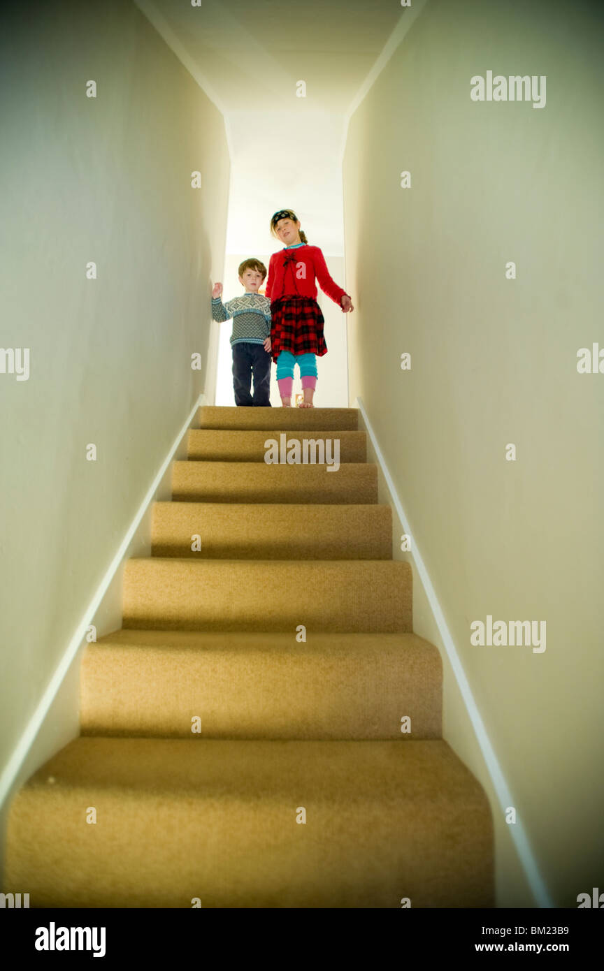 Low angle view of a boy and a girl on the top of the staircase, Ithaca, New York State, USA - Stock Image