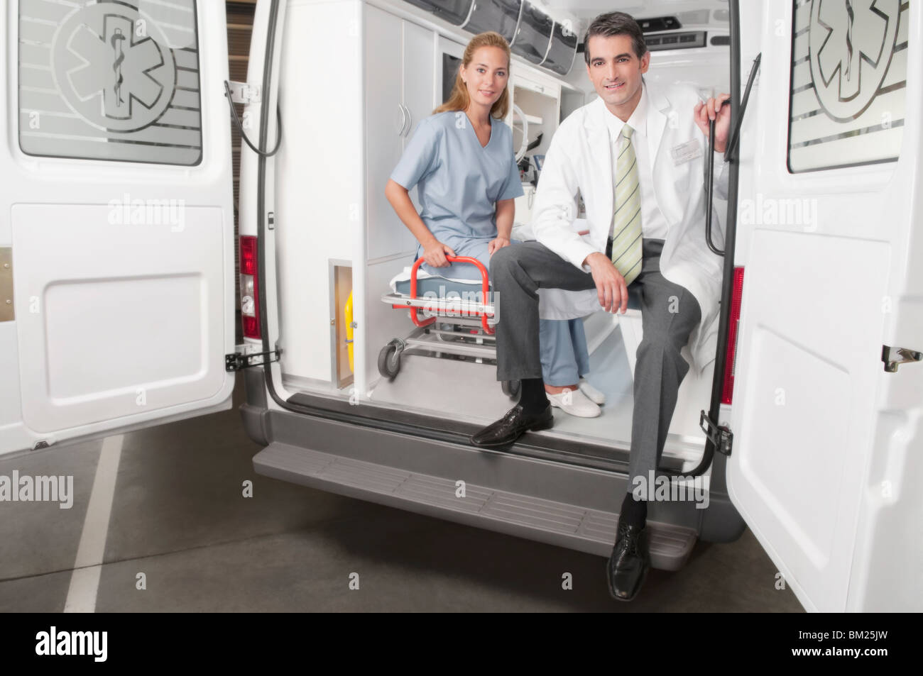 Doctor with a female nurse in an ambulance - Stock Image