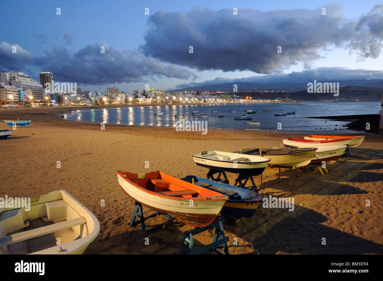 Fishing boats on the beach. Las Palmas de Gran Canaria, Spain - Stock Image