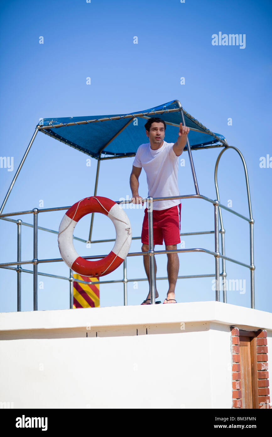 Lifeguard pointing - Stock Image