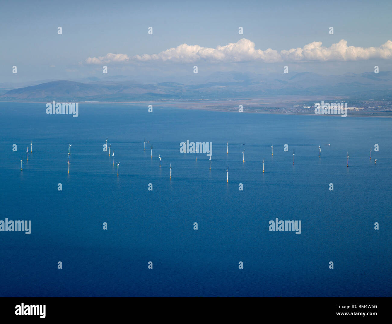 Offshore Wind Farm,  Morcambe Bay, off the English West Coast south of Barrow in Furness, UK, with the Lake District - Stock Image