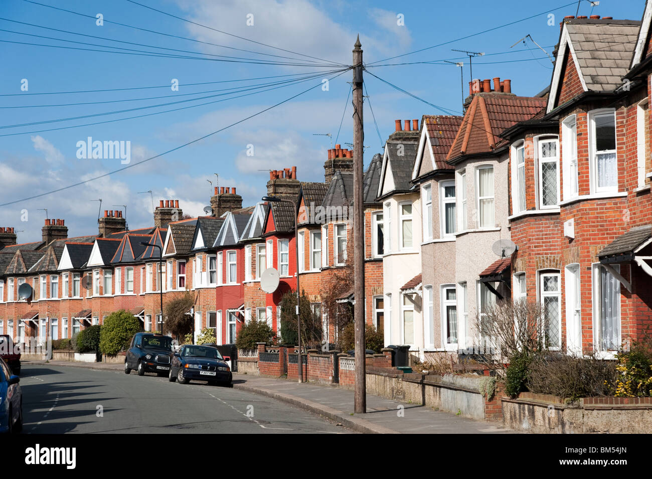 Row of terraced houses in residential Street, London, England, UK Stock Photo