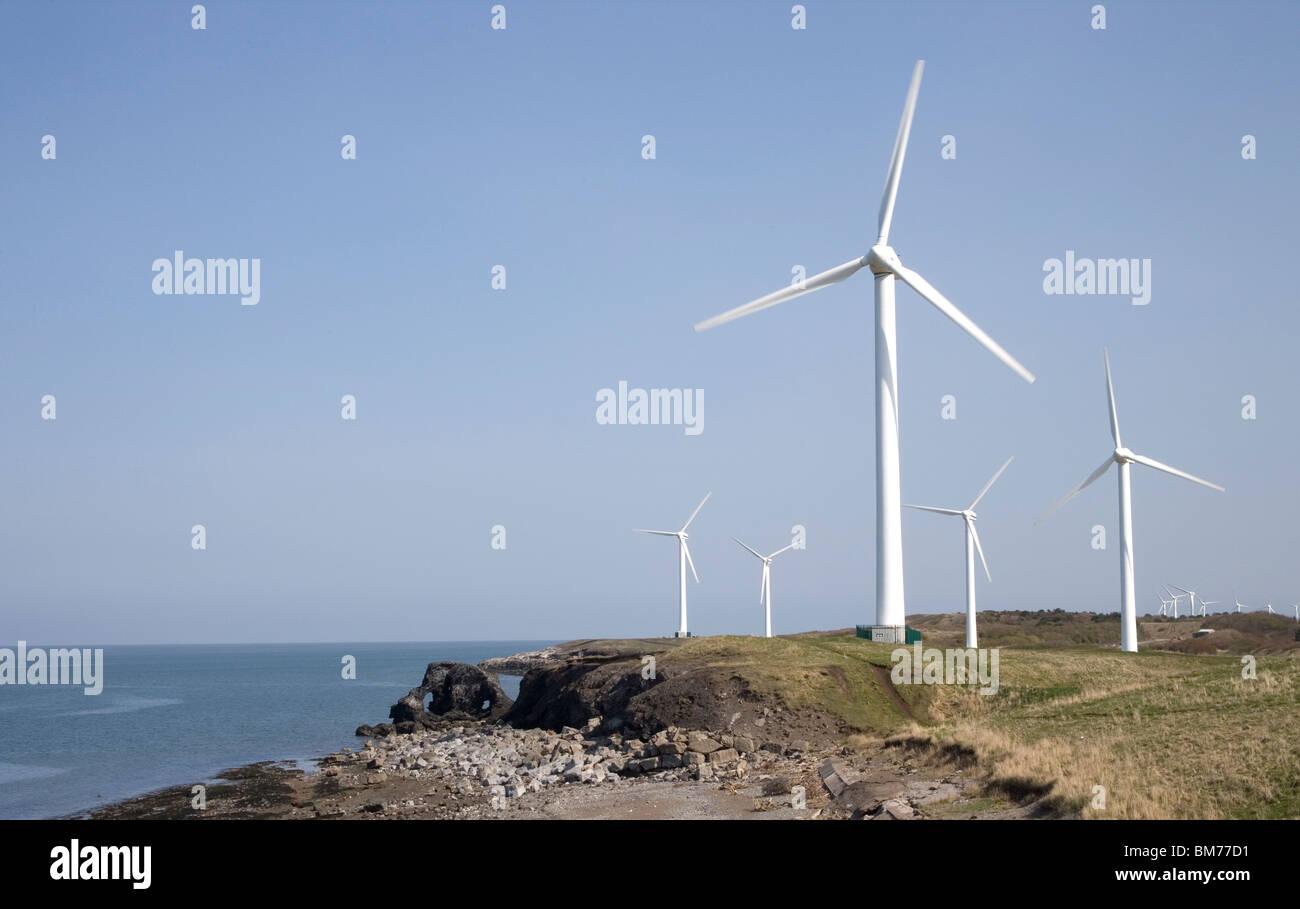 workington wind farm on the cumbria coast Stock Photo