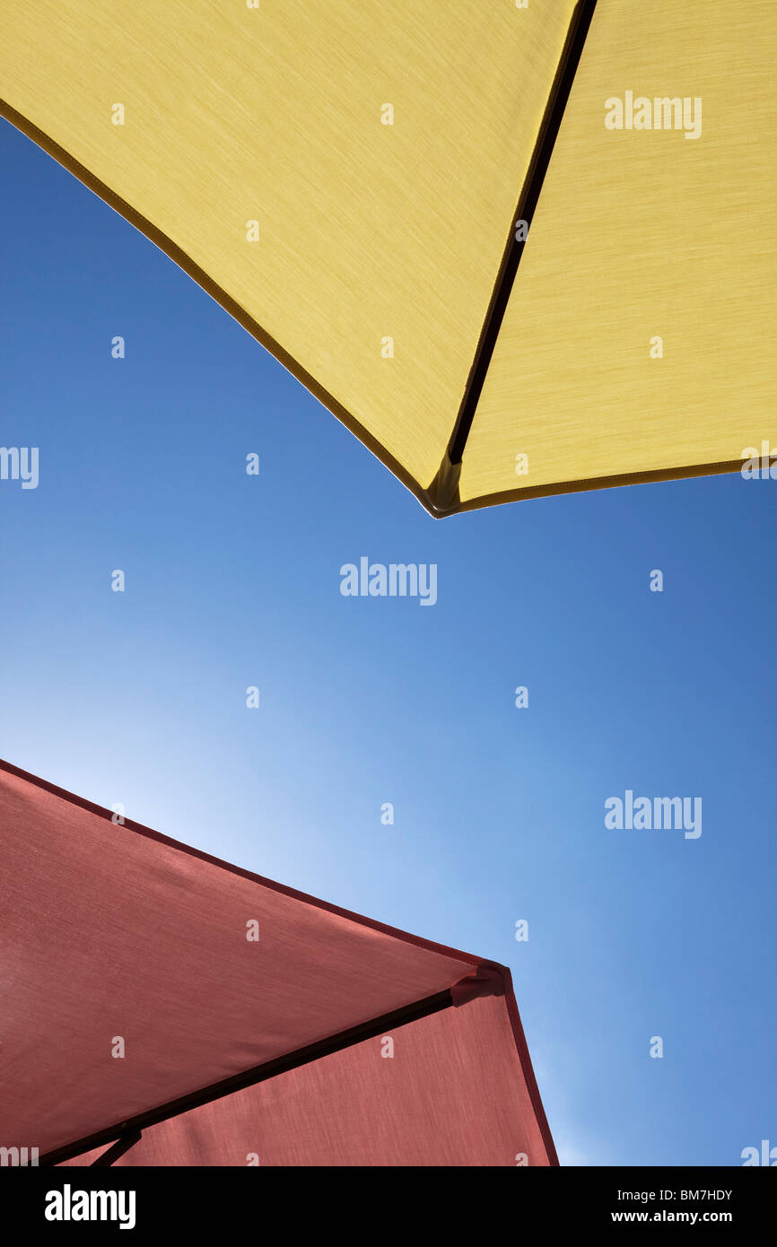 Two beach umbrellas, close-up, directly below - Stock Image