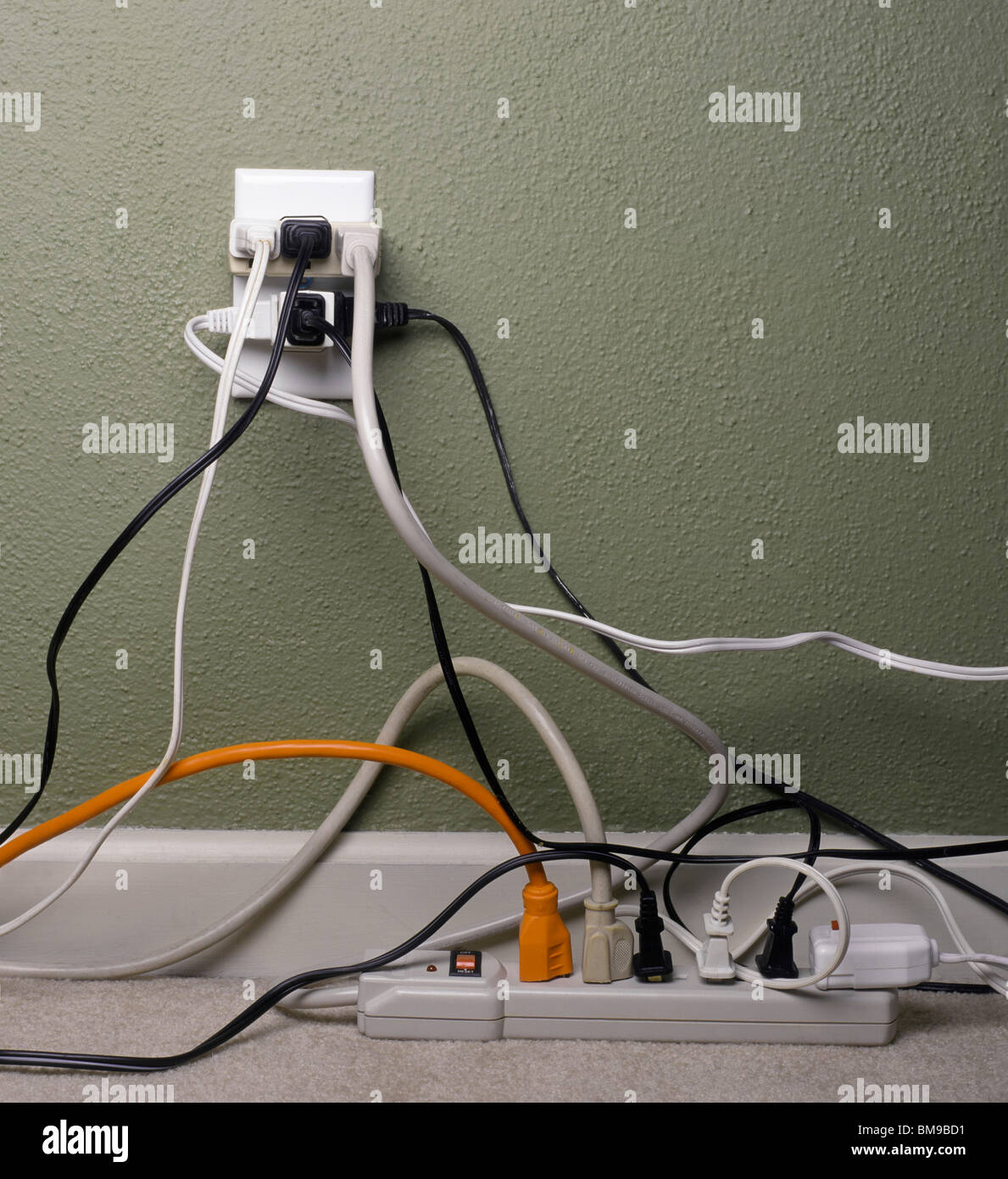 Multiple electrical plugs in overloaded wall outlet Stock Photo ...