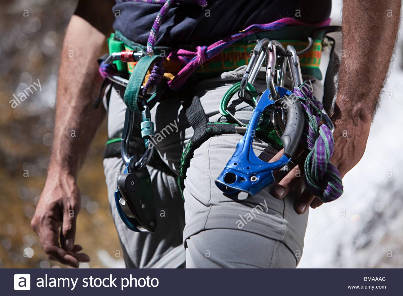 Equipment around waist of rock climber - Stock Image