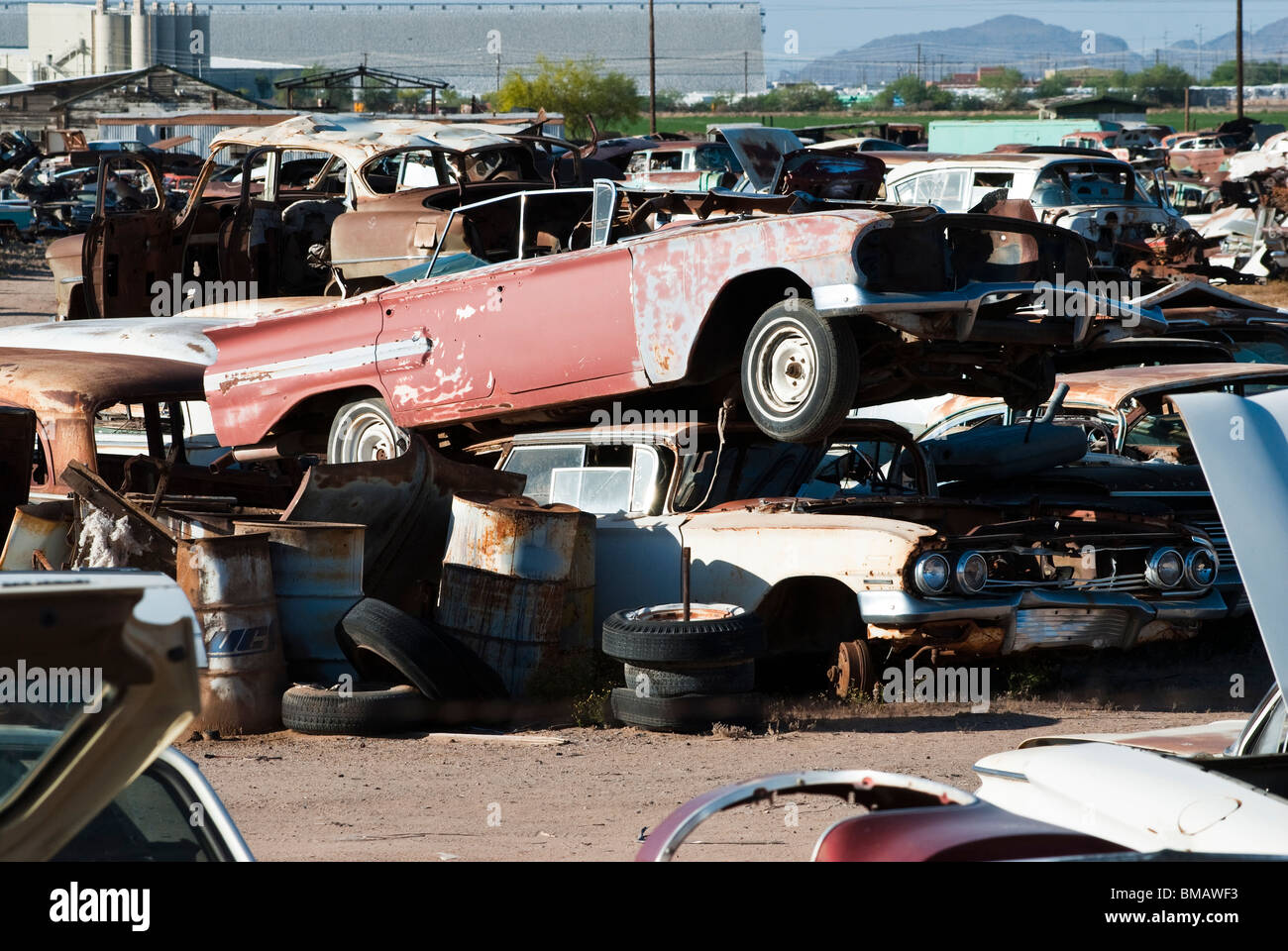 old vehicles being recycled for parts and scrap metal in an auto ...