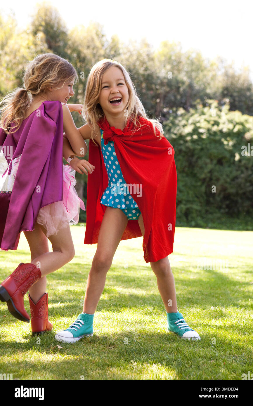 Girls in capes having fun - Stock Image