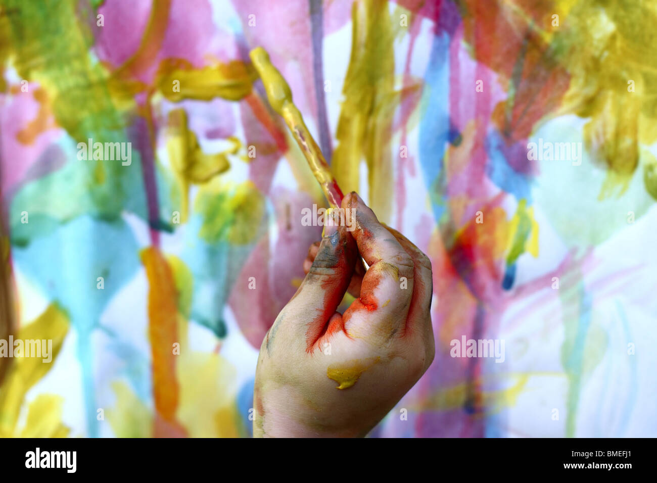 children little artist painting hand brush colorful watercolor art - Stock Image