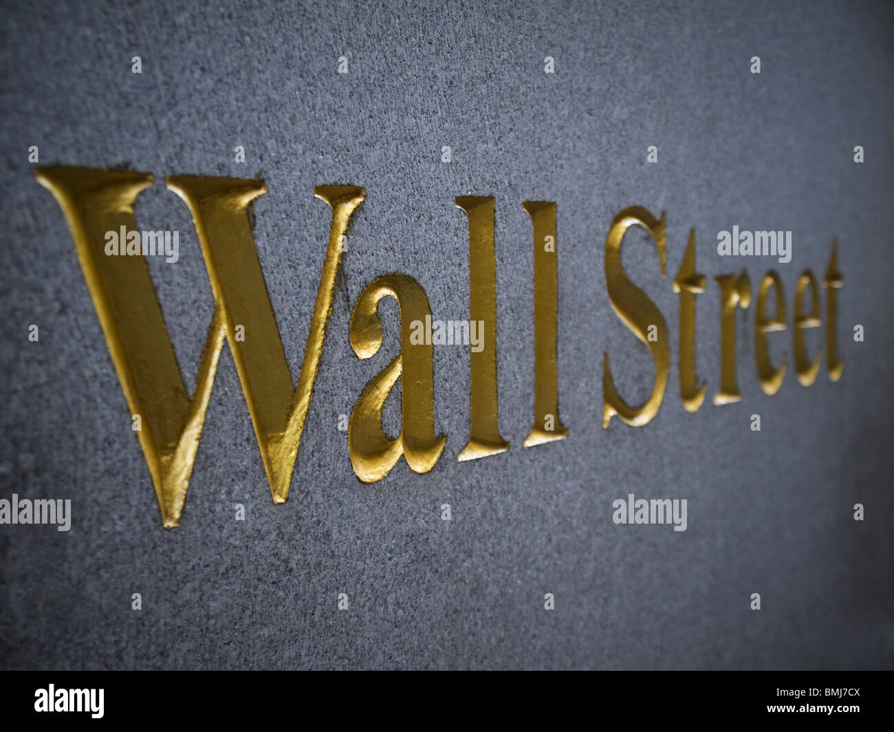 Wall Street carved in stone with golden letters. - Stock Image