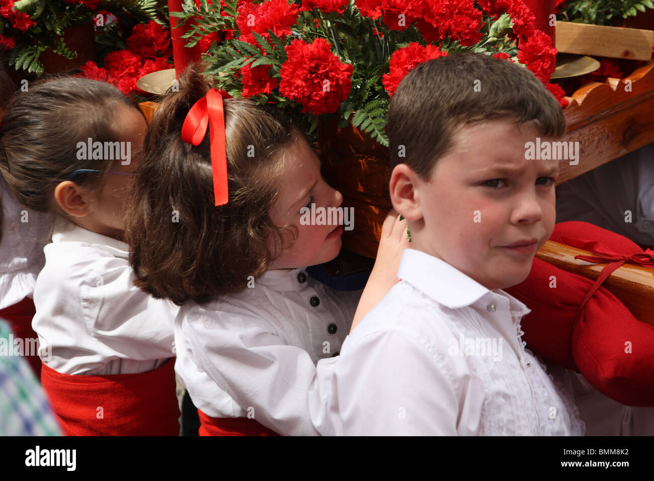 children-carrying-a-religious-float-or-p