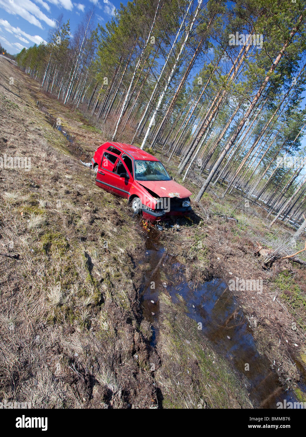 Crashed Volkswagen Golf at roadside ditch , Finland - Stock Image