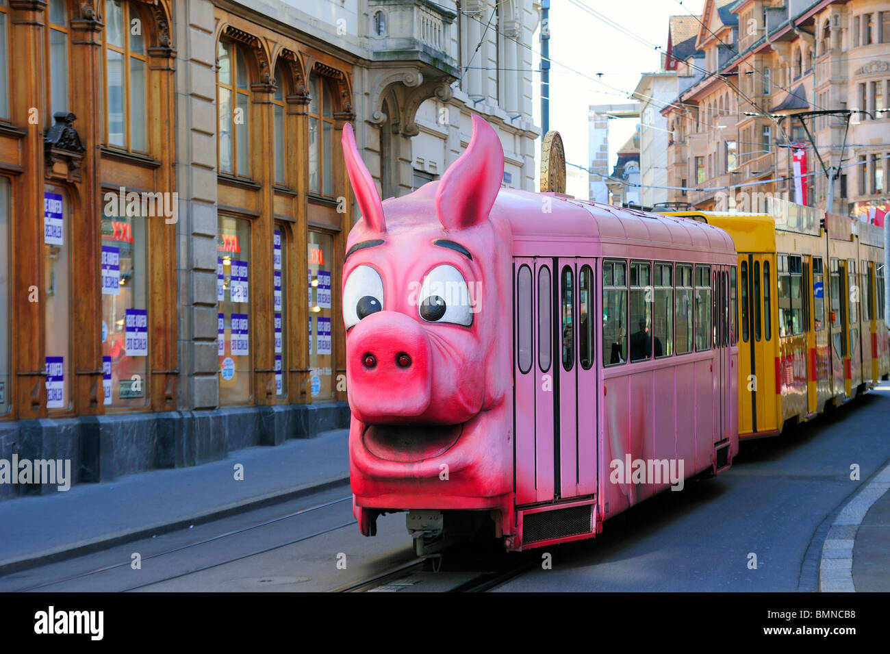 Swiss humour - a pig-shaped tram in Basel (Bale), Switzerland - Stock Image