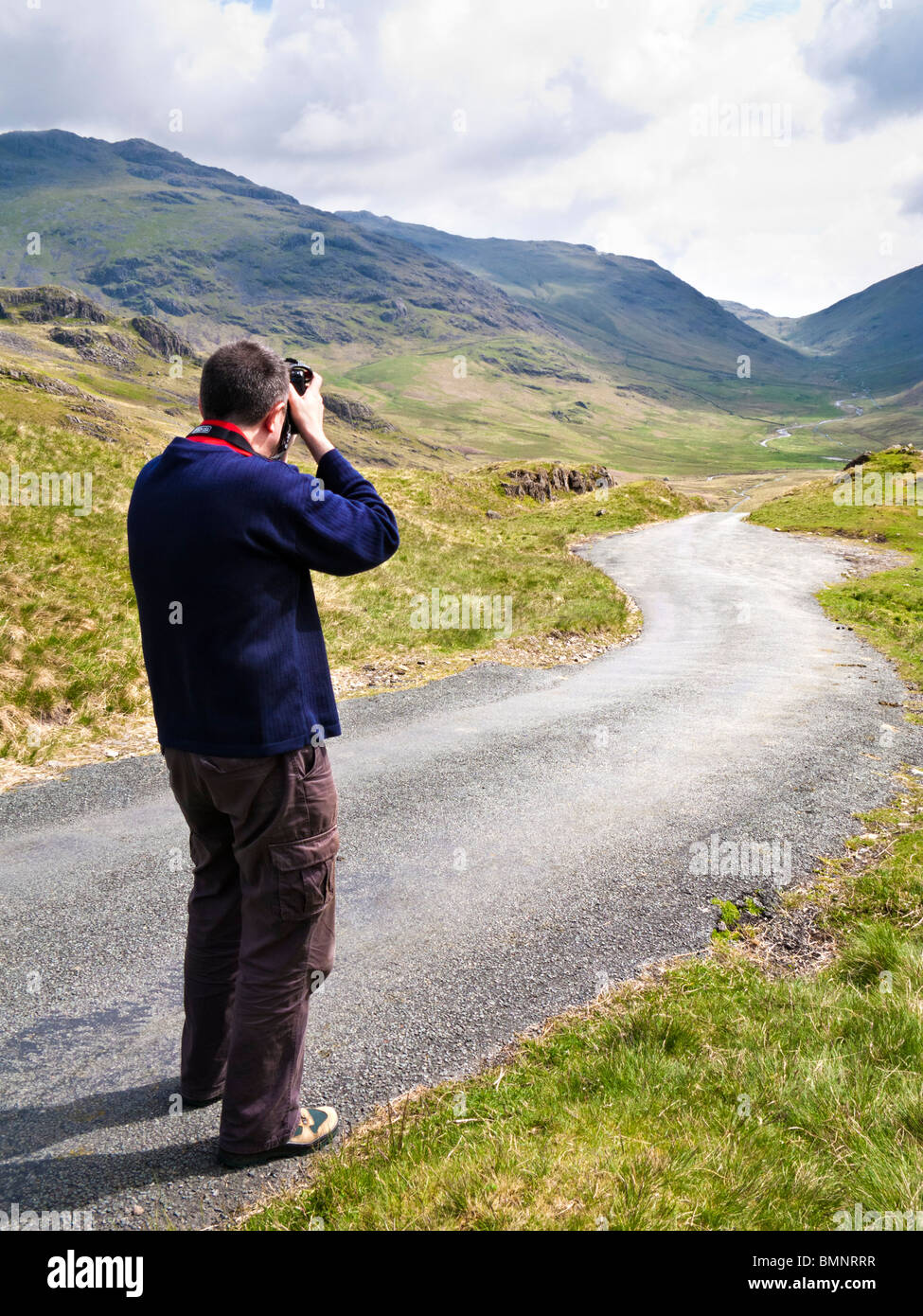 Tourist Photographer in The Lake District England UK - MR - Stock Image