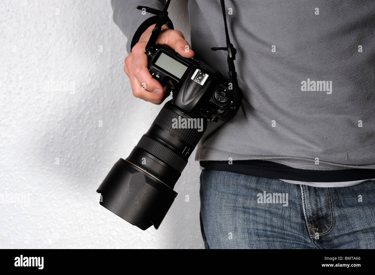 Man holding a camera - Stock Image