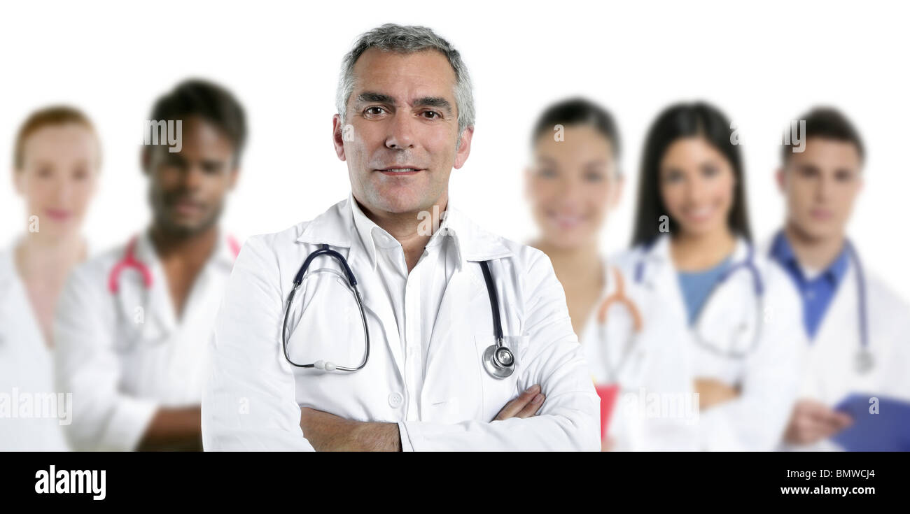 expertise gray hair doctor multiracial nurse team row over white - Stock Image
