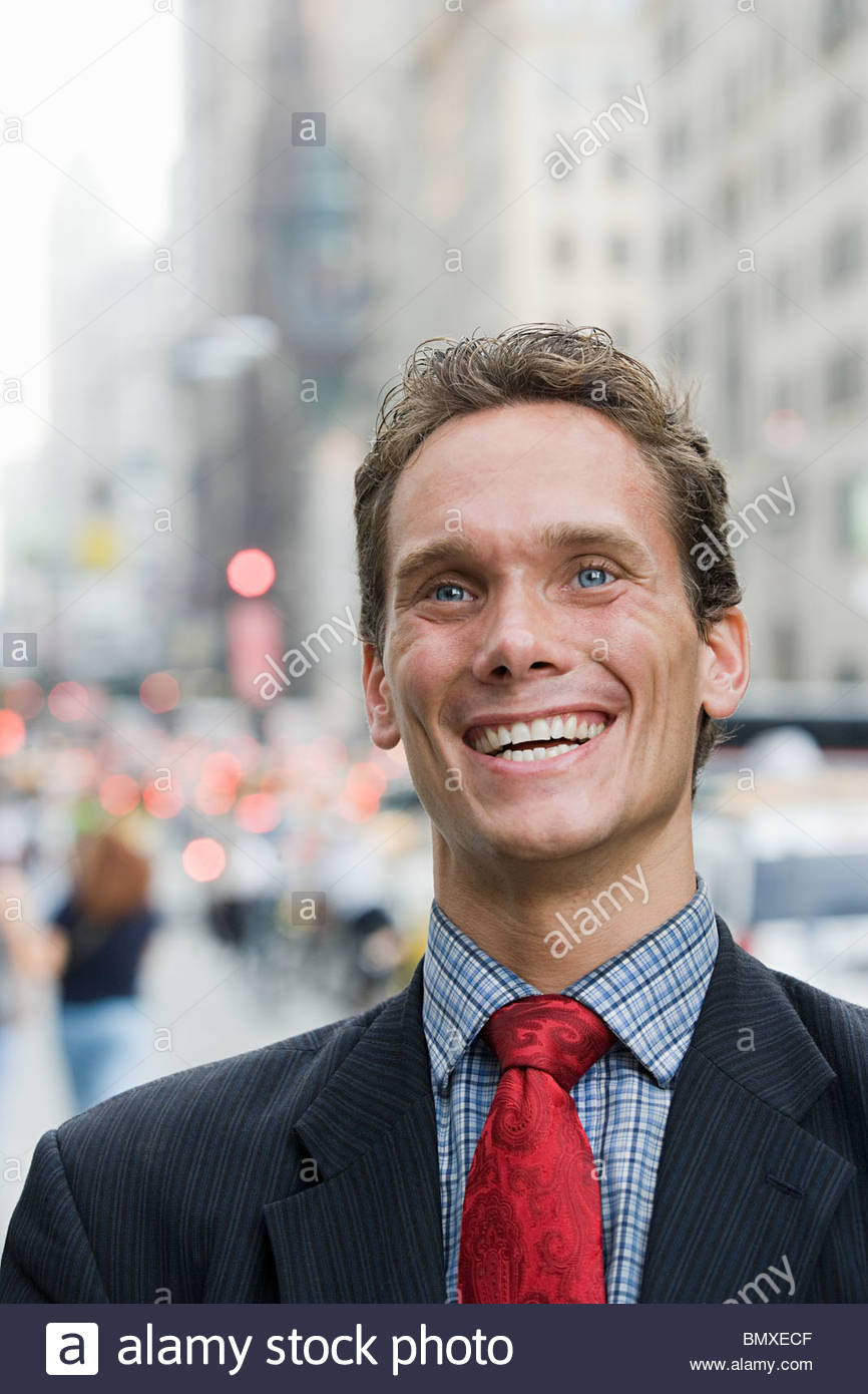 Portrait of businessman in street - Stock Image