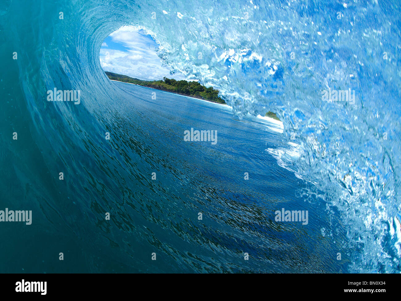 In the tube of a wave - Stock Image