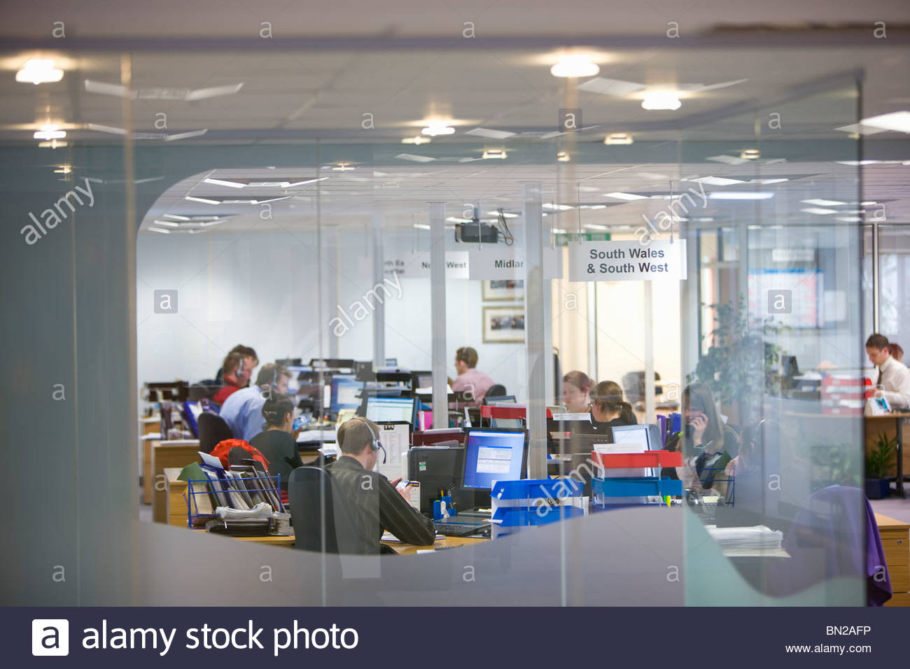 Sales people working in call center office - Stock Image