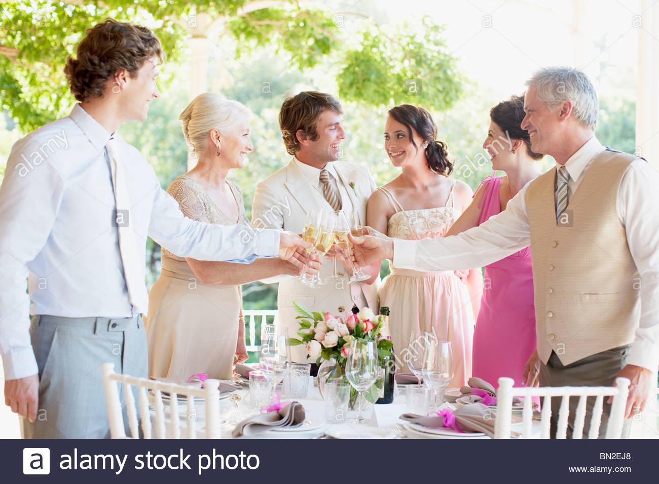 Family toasting at wedding reception - Stock Image