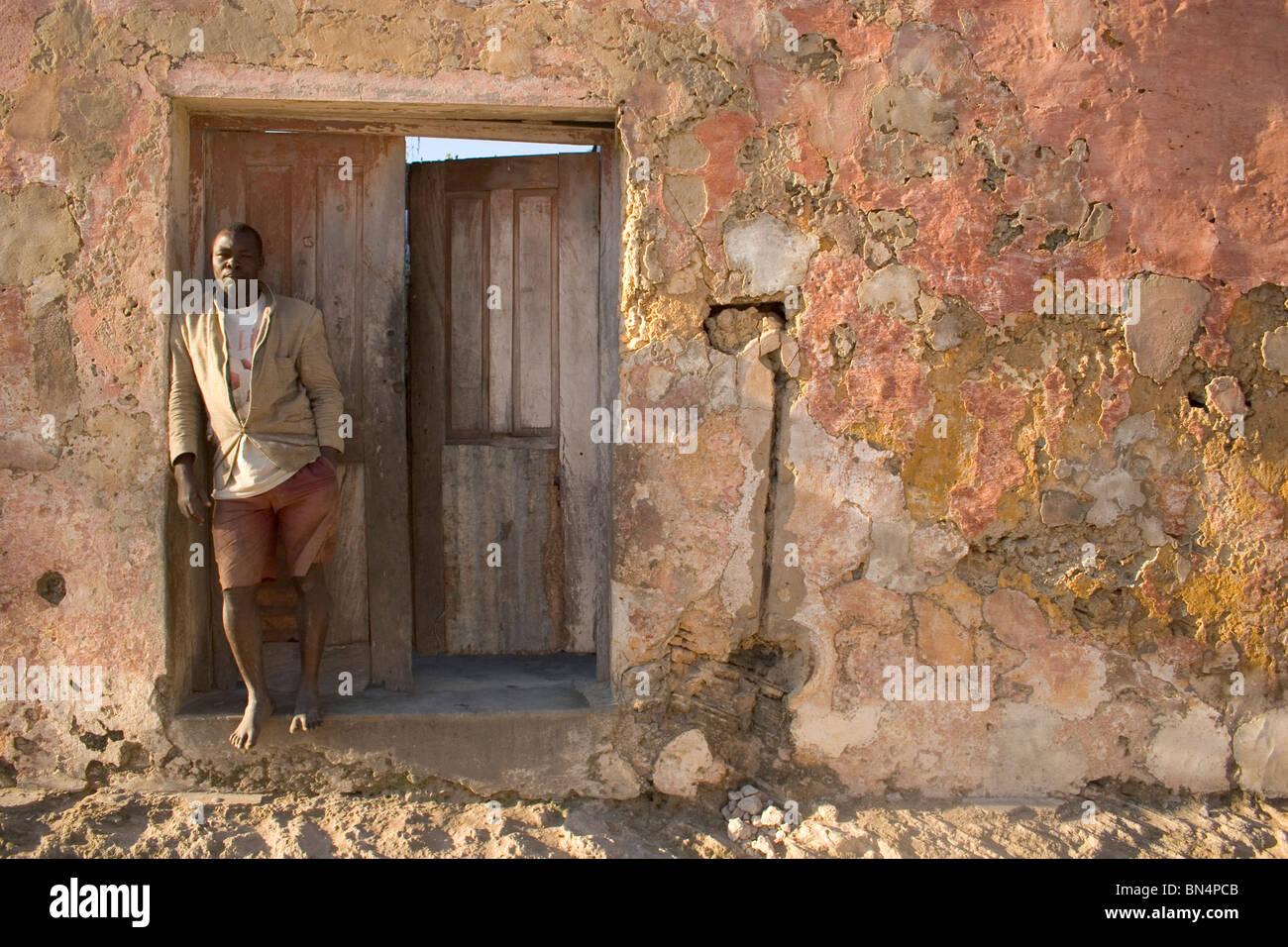 Man standing in doorway, Ilha de Mozambique - Stock Image