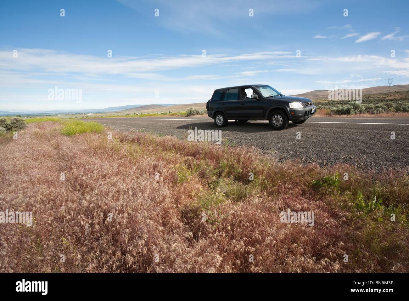 Car parked along the Vantage Highway near Ellensburg - Kittitas County, Washington - Stock Image