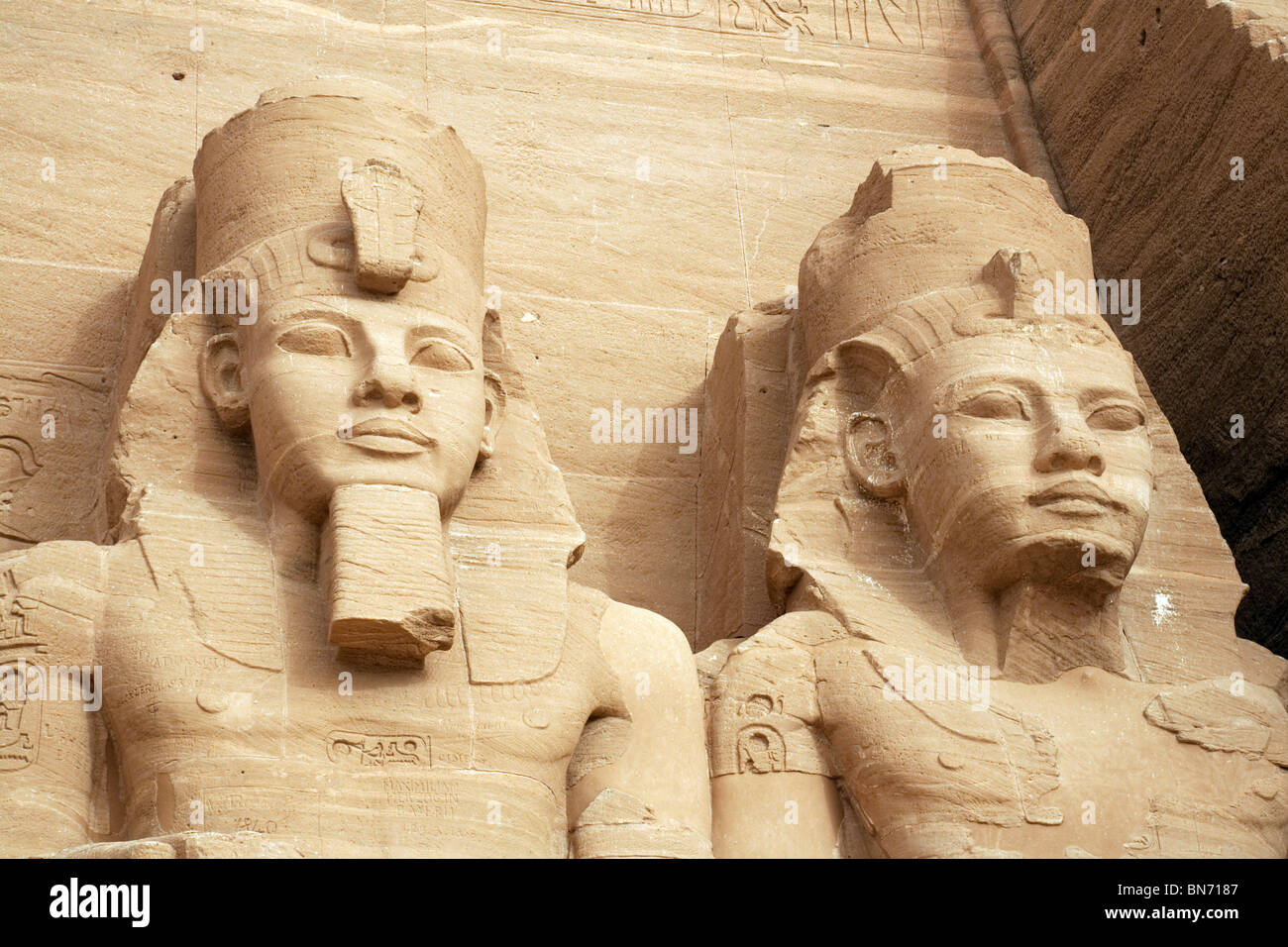 close-up-of-the-heads-of-two-of-the-statues-of-ramses-2-at-the-great-BN7187.jpg