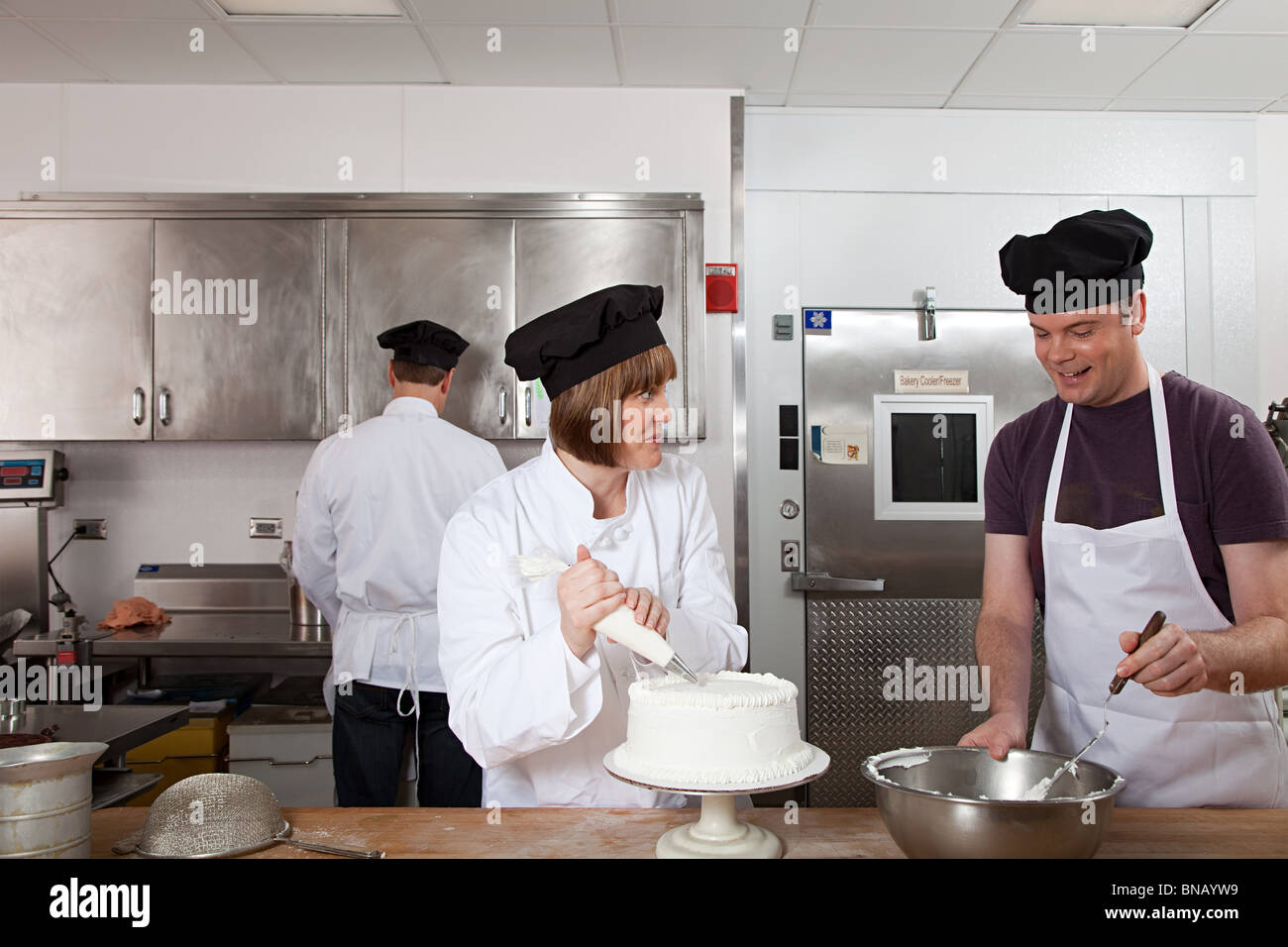 Making cake in commercial kitchen - Stock Image