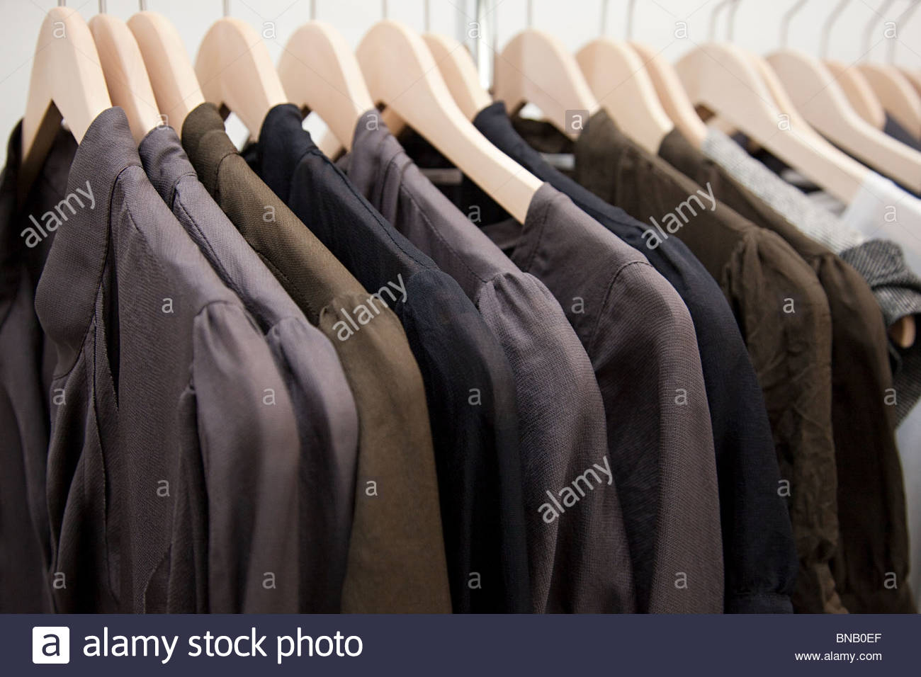 Clothing on a rail - Stock Image