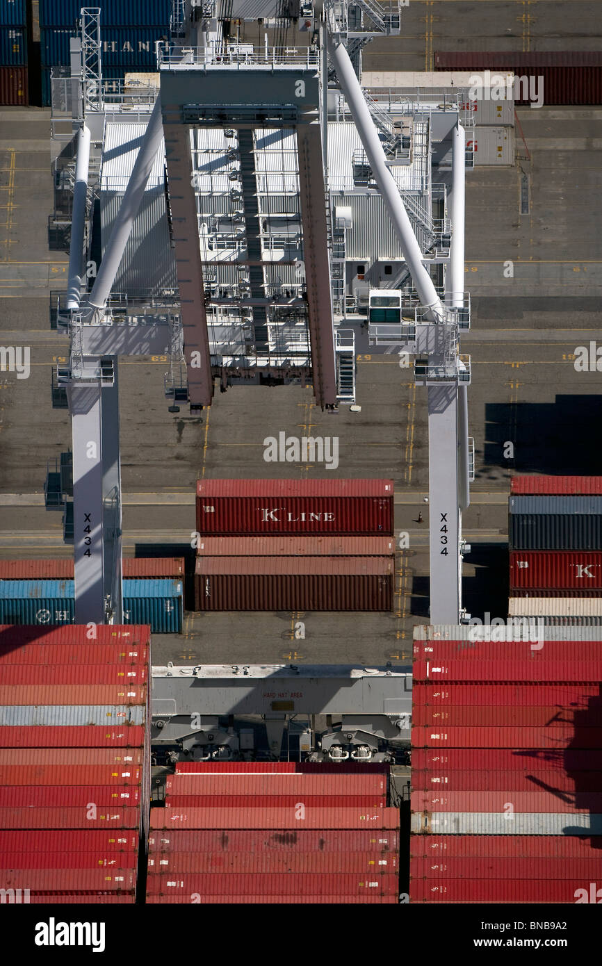 aerial view above crane loading containers Port of Oakland California - Stock Image