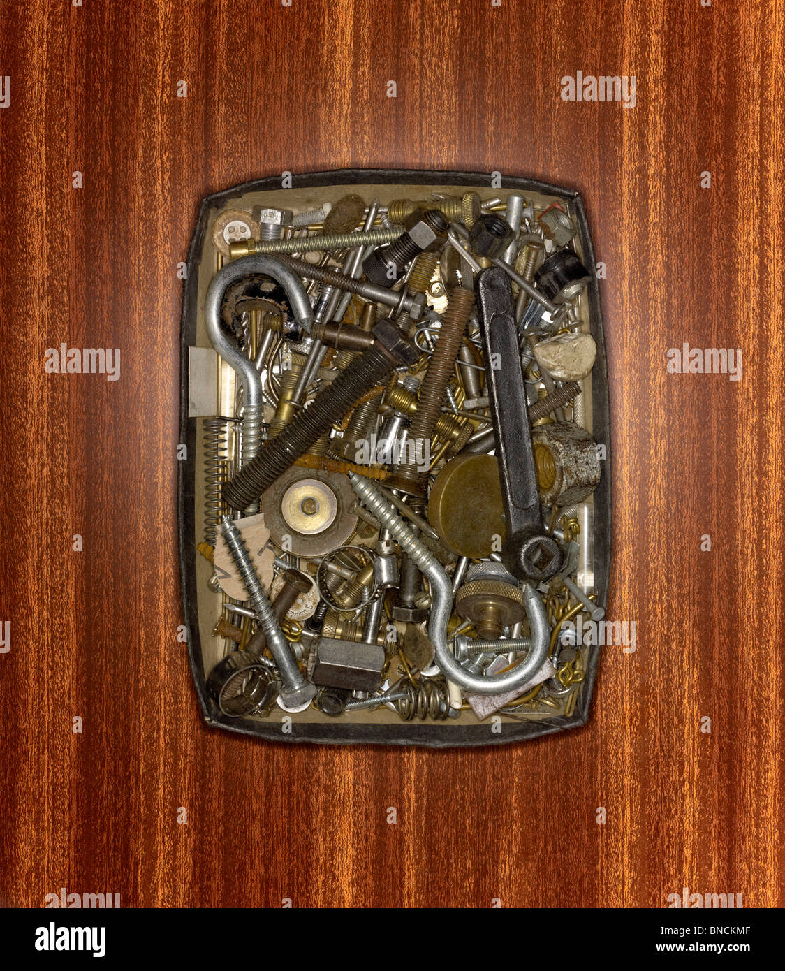 A box of saved nuts, bolts and screws - Stock Image