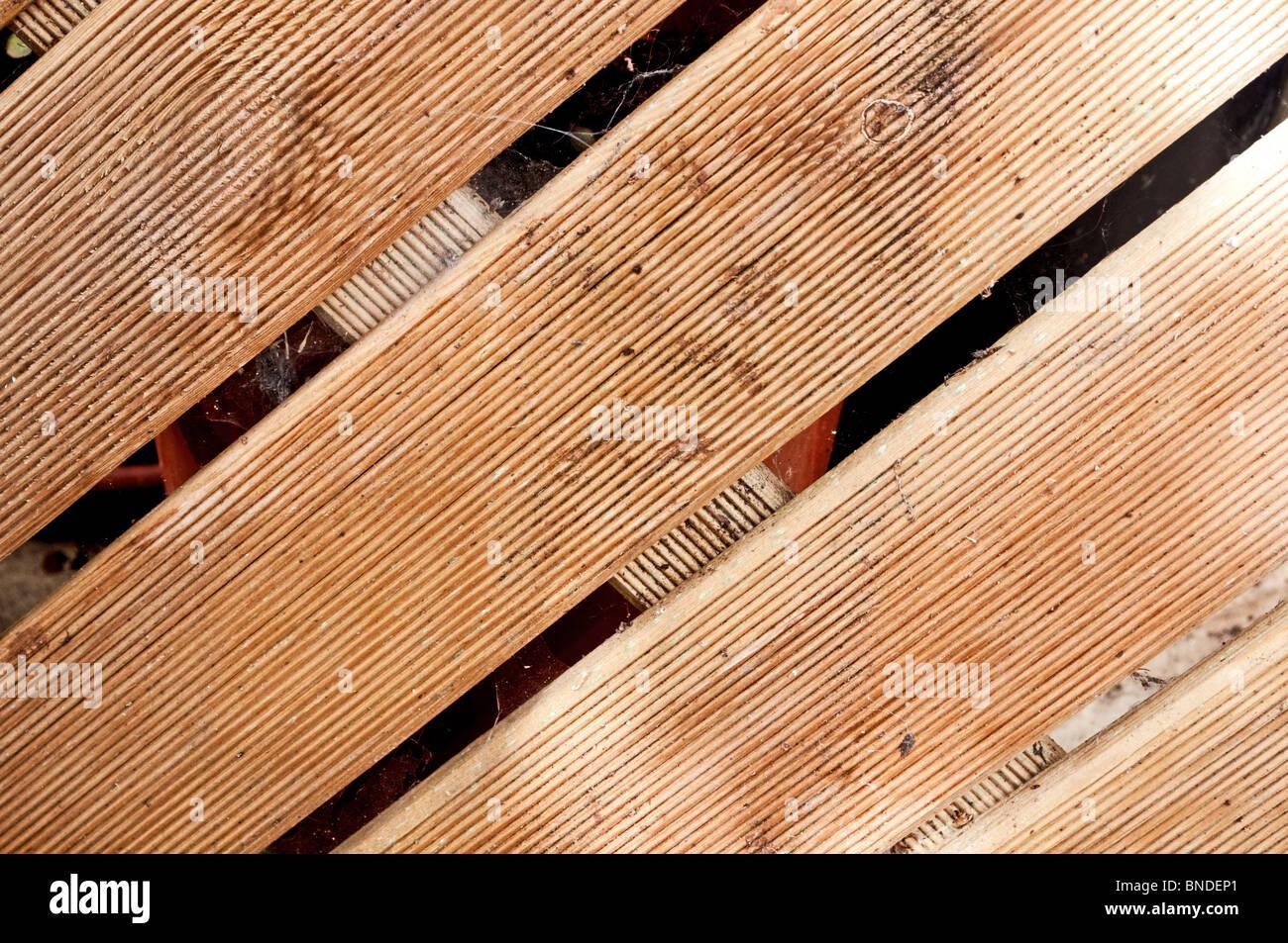 Diagonal Weathered Wood Decking - Stock Image