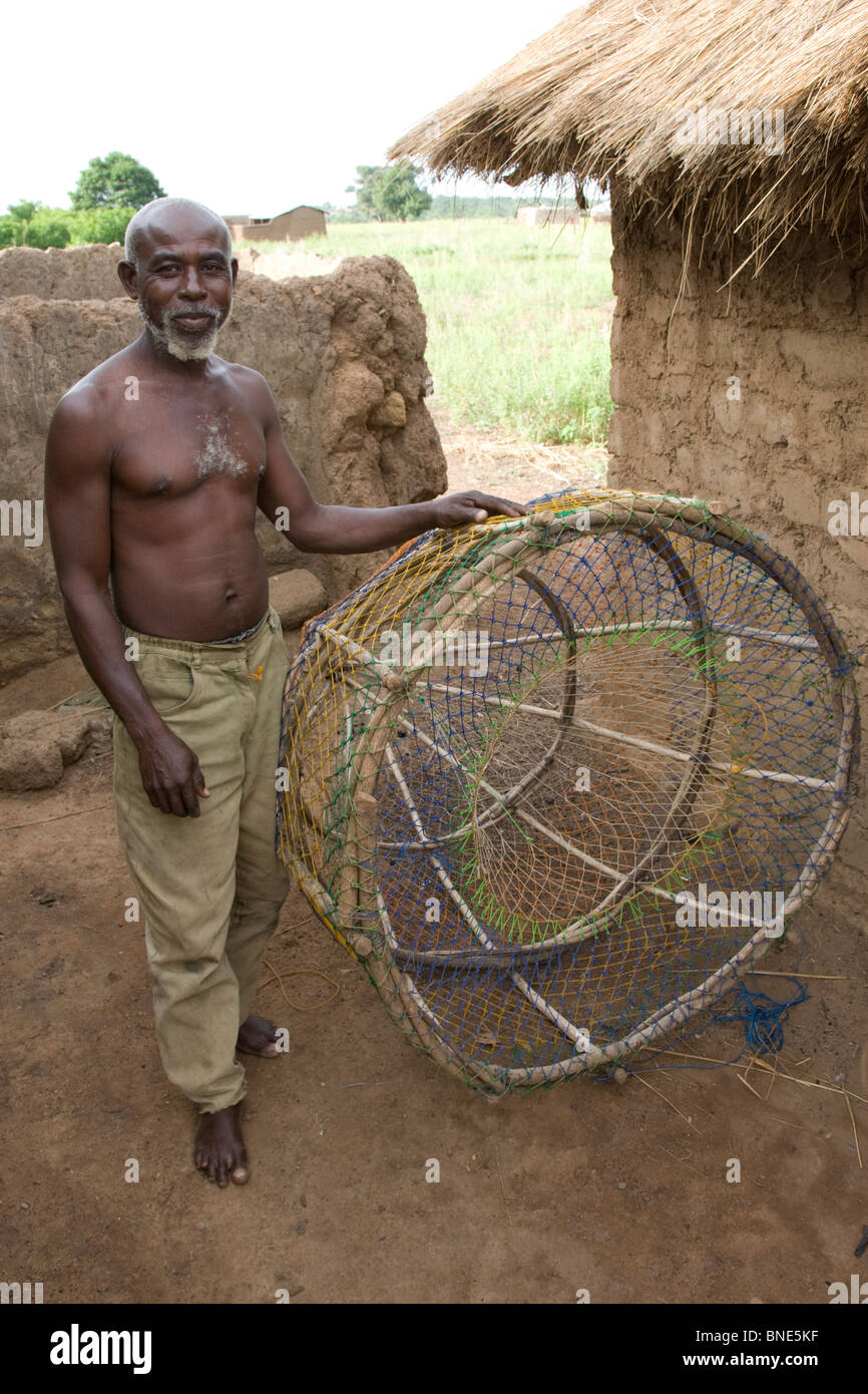 Hausa fisherman, a migrant, in a Lobi village, Talawona, near Wechiau, Ghana. - Stock Image