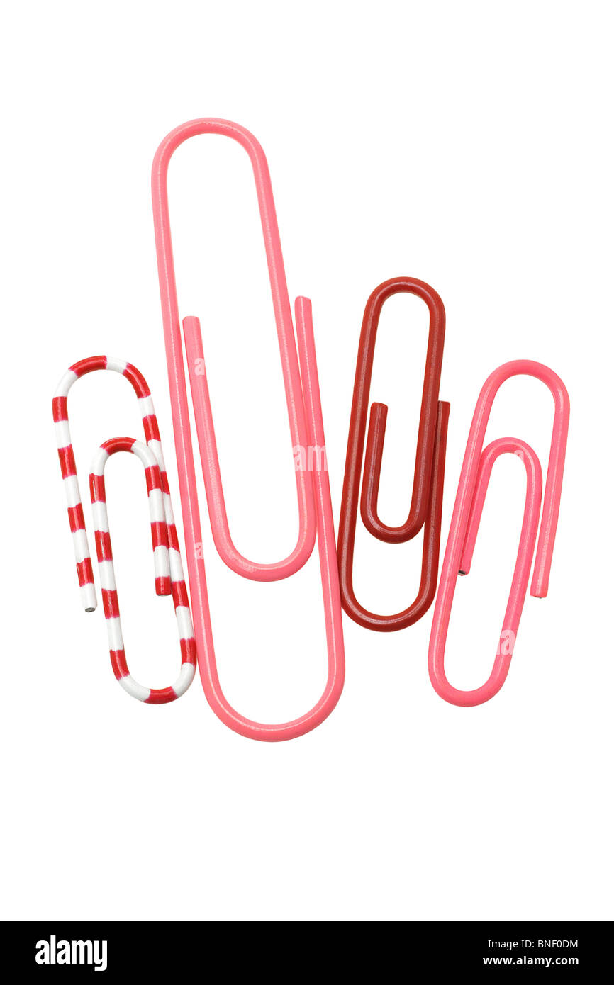 Four color paper clips on white background - Stock Image