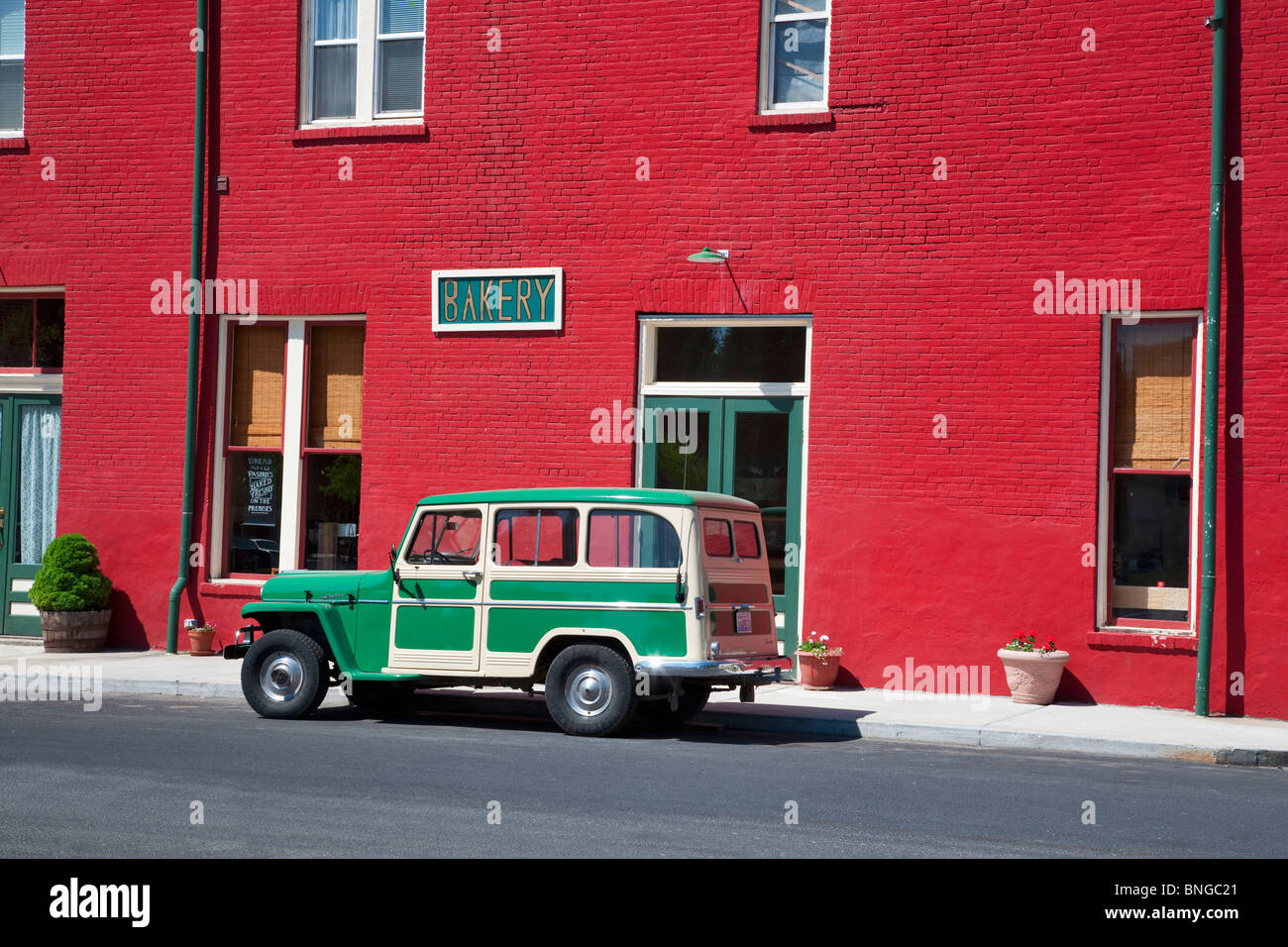 Antique Willy's parked in front of red buiding. Palouse, Washington. - Stock Image