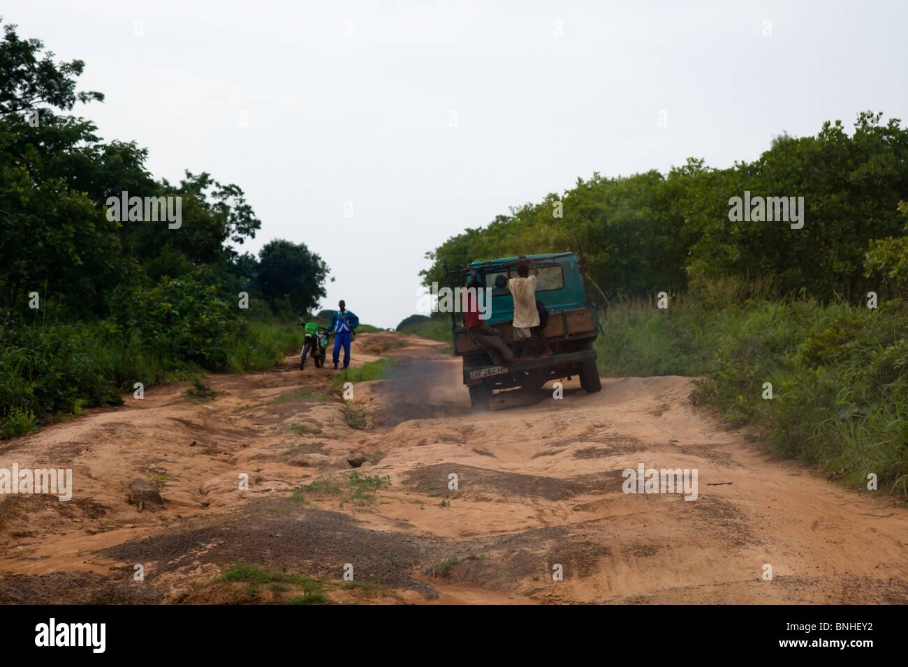 Truck negotiating a rural dirt road in the Gonja Triangle, Damango district, of Northwest Ghana. Stock Photo