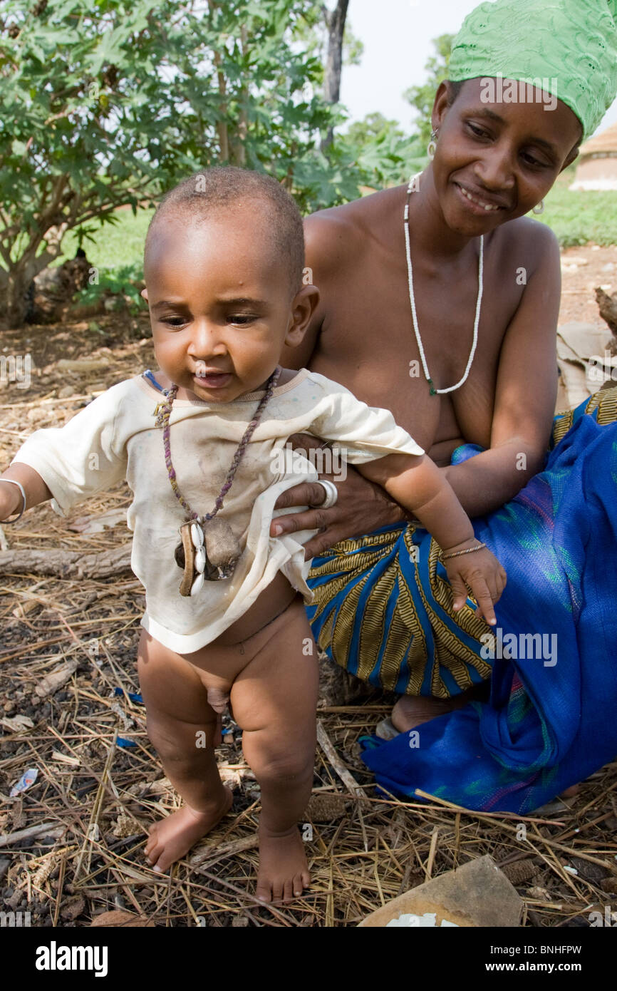A woman and infant from a Fulani compound in the village Sor No. 1 in the Gonja Triangle, Damango district. Stock Photo