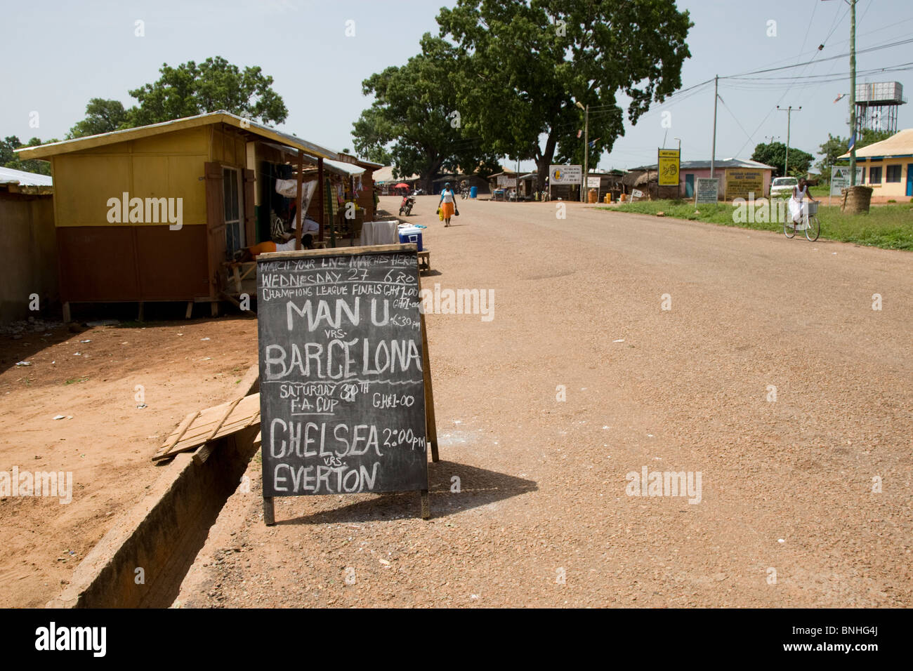 Advertisement for a bar in a small town in rural Ghana, showing the Champions League final and FA Cup final in 2009. - Stock Image