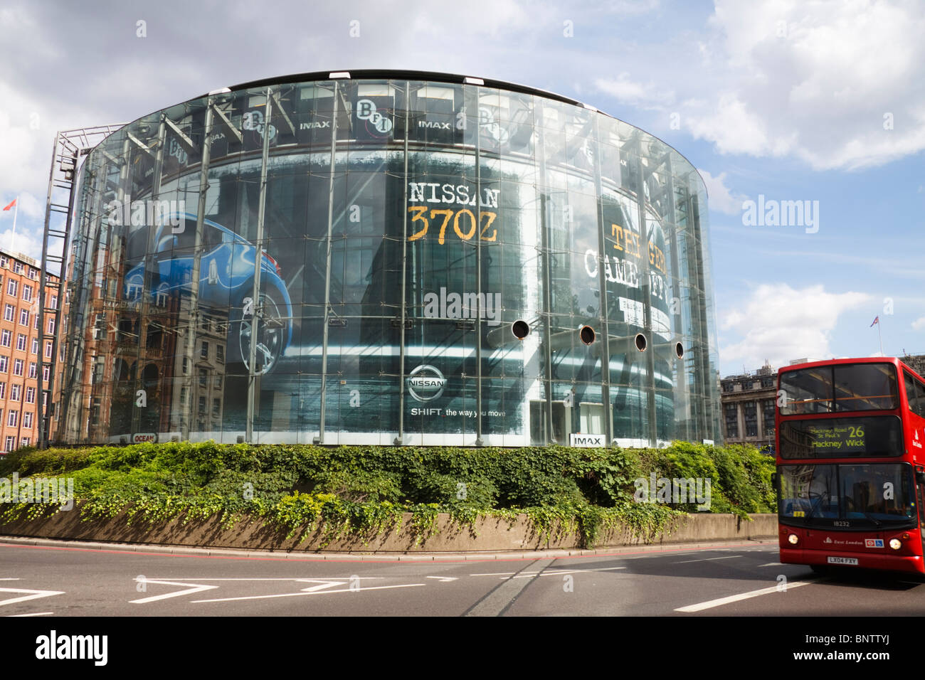 The London BFI Imax building with a red London bus, England, UK - Stock Image