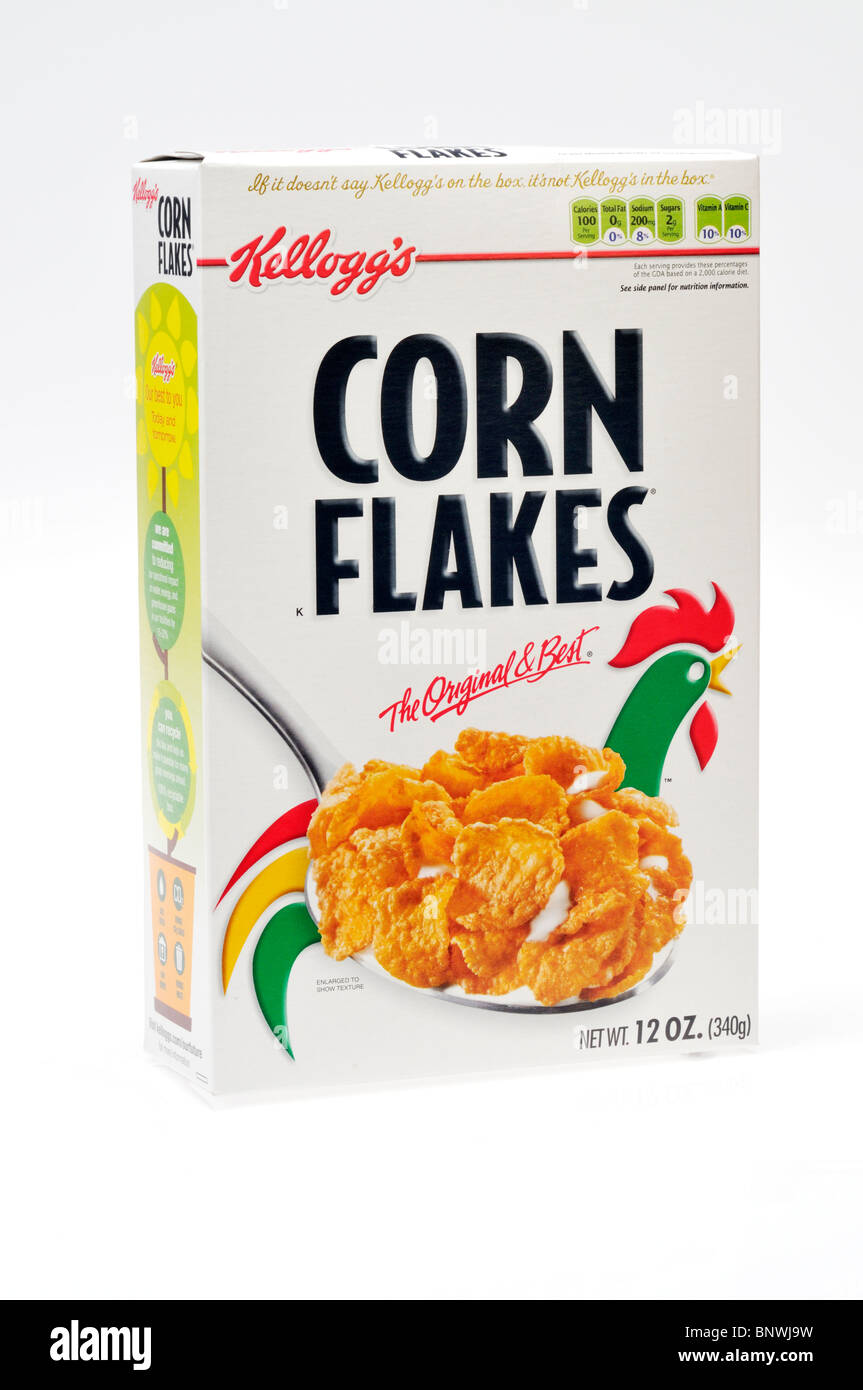 An unopened box of Kellogg's corn flakes breakfast cereal on white background, cut out. Stock Photo