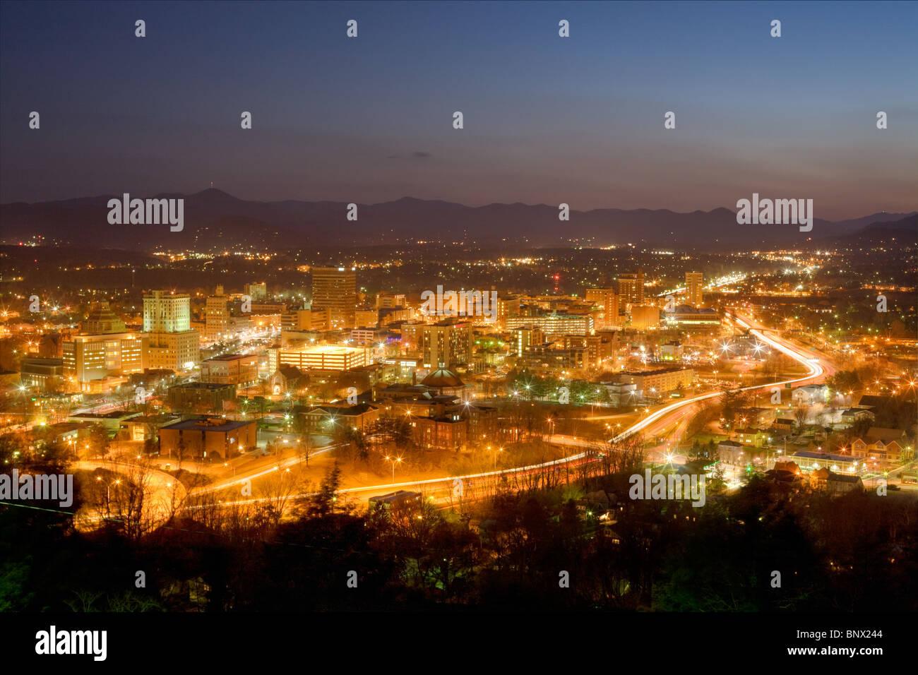 City skyline of Asheville, North Carolina, nestled in Blue Ridge Mountains - Stock Image