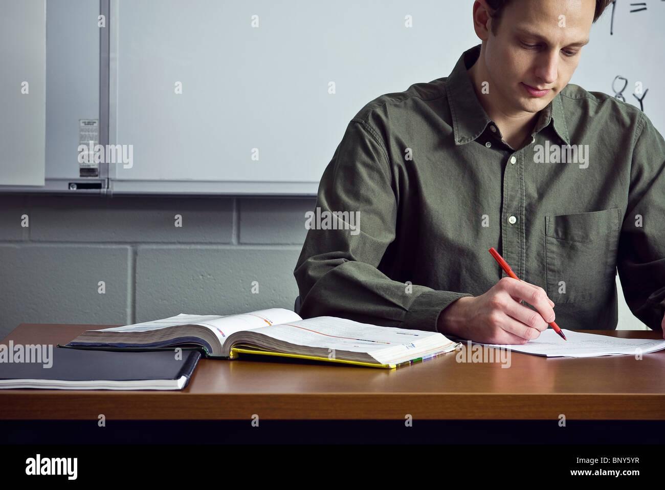 teacher grading homework assignments stock photo 30715547 alamy