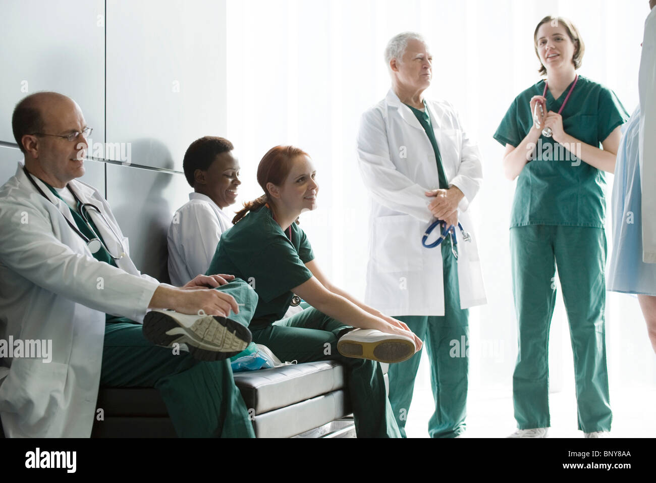 Healthcare workers chatting while on strike - Stock Image