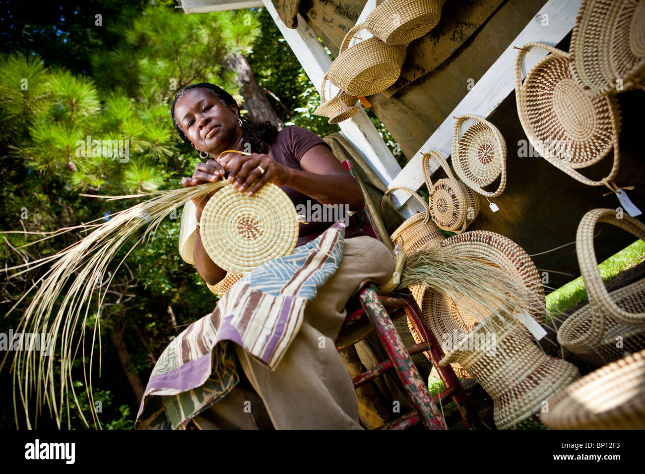 Barbara Manigault, a Gullah sweet grass basket weaver at her stand in Mt Pleasant, SC. Stock Photo